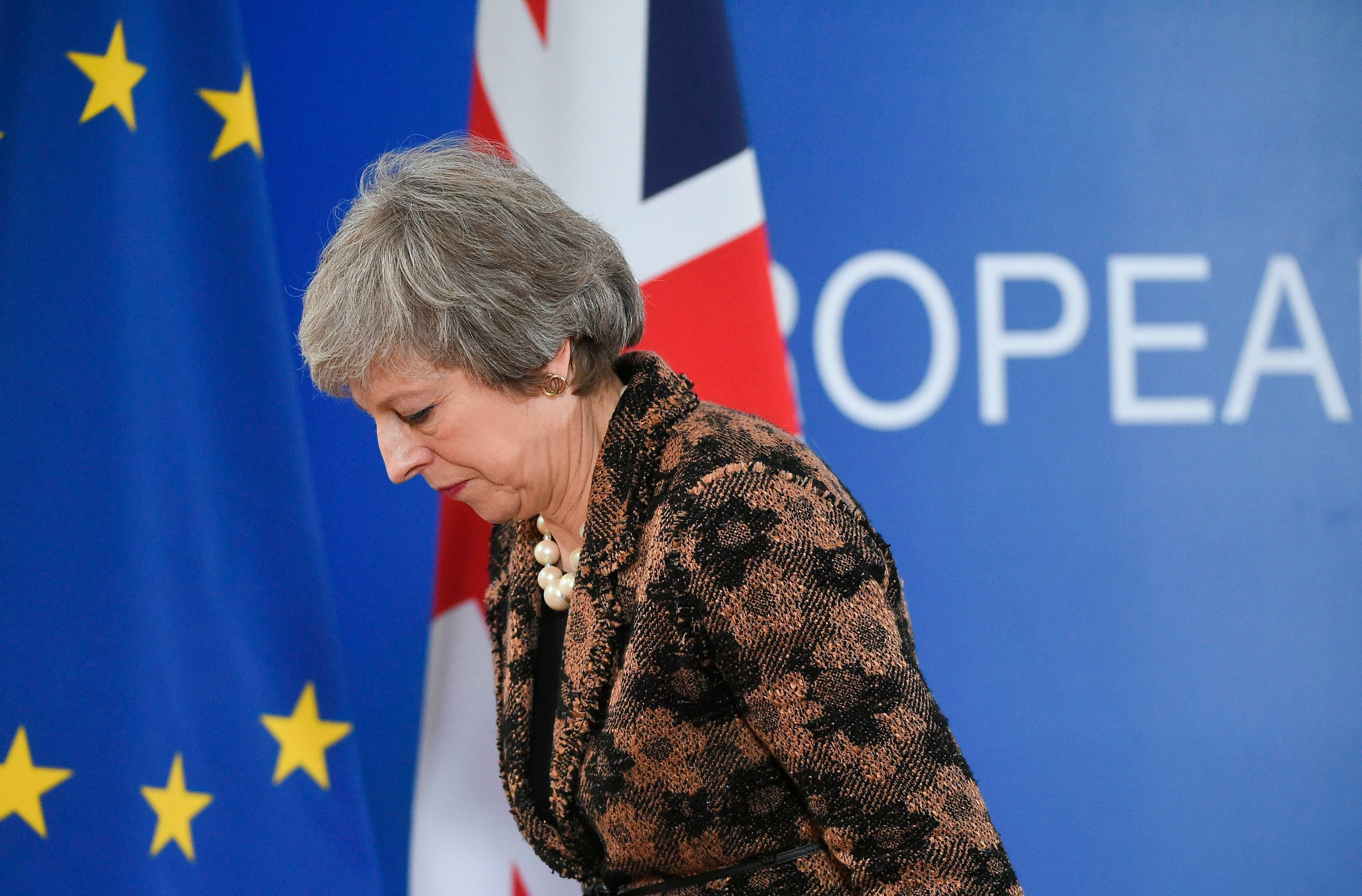 TOPSHOT - Britain's Prime Minister Theresa May leaves after speaking during a press conference on December 14, 2018 in Brussels during the second day of a European Summit aimed at discussing the Brexit deal, the long-term budget and the single market. - May says further Brexit talks will take place with EU in coming days, AFP reported on December 14. (Photo by JOHN THYS / AFP)        (Photo credit should read JOHN THYS/AFP/Getty Images)