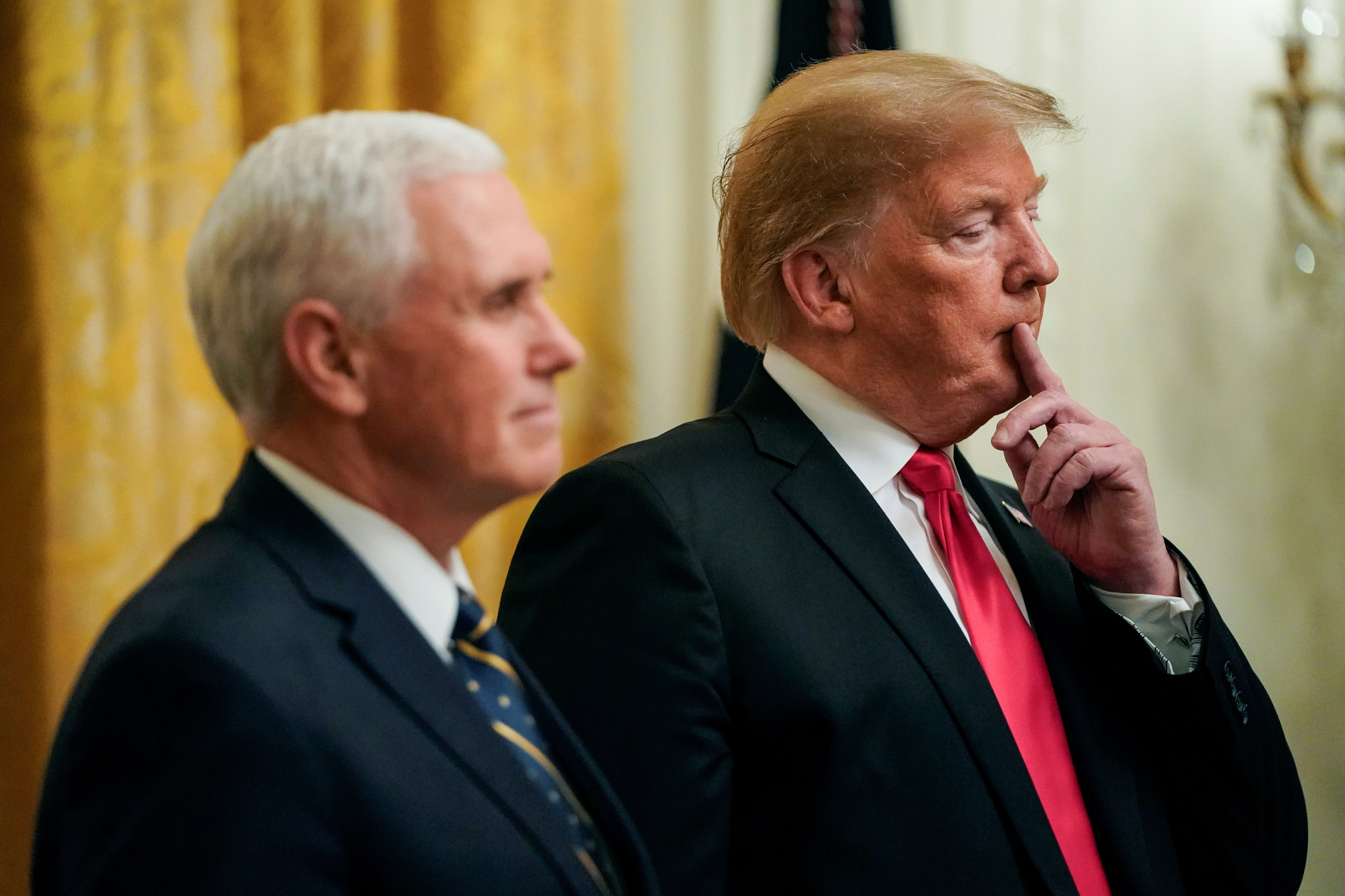 U.S. President Donald Trump stands with U.S. Vice President Mike Pence as he welcomes the 2018 College Football Playoff National Champion Clemson Tigers at the White House in Washington, U.S., January 14, 2019. REUTERS/Joshua Roberts