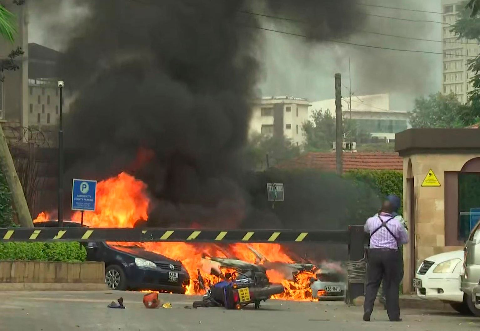 This frame taken from video shows a scene of an explosion in Kenya's capital, Nairobi, Tuesday Jan. 15, 2019. Gunfire and explosions were reported near an upscale hotel complex. (AP Photo/Josphat Kasire)