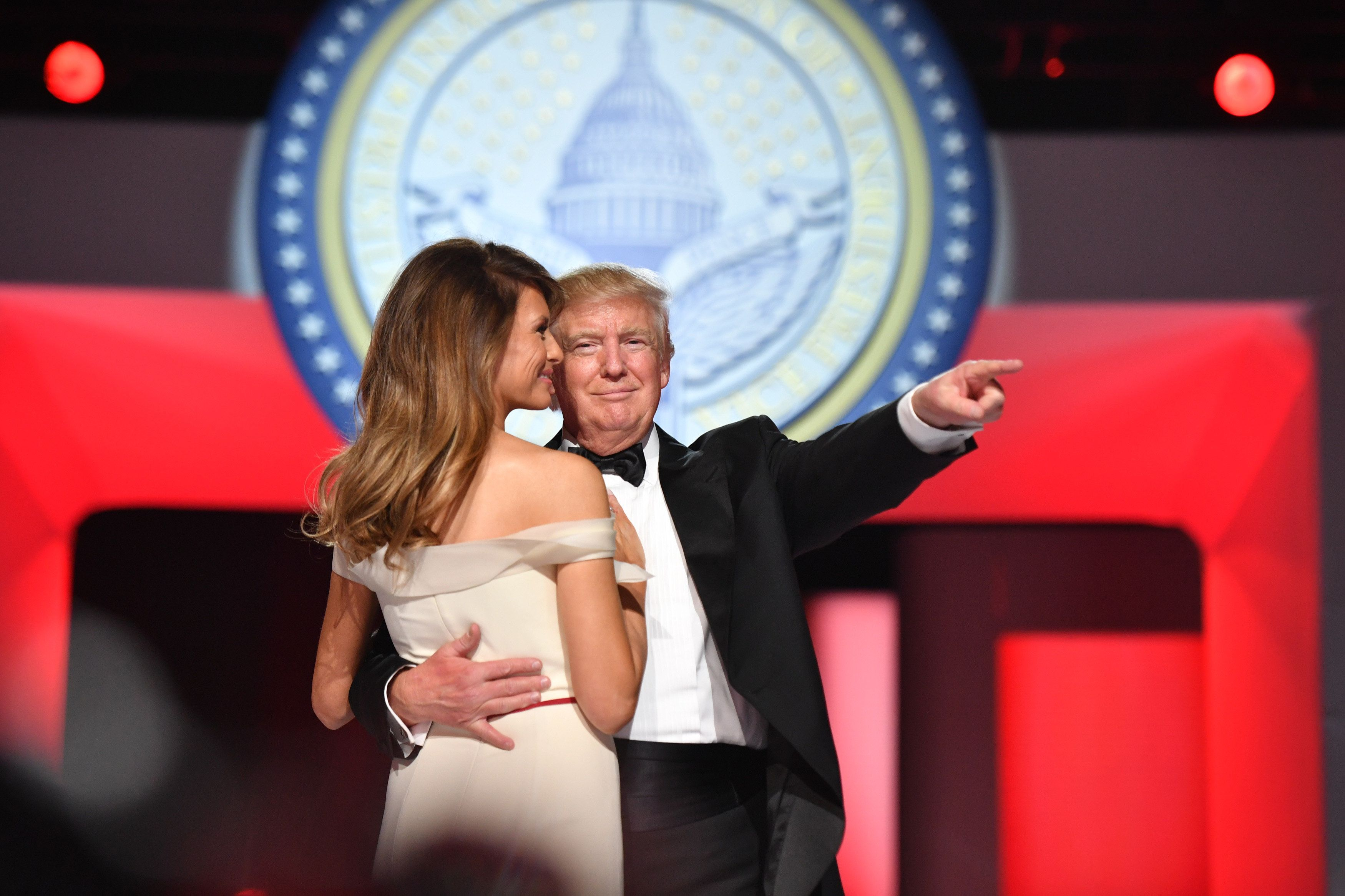 FILE: U.S. President Donald Trump, right, gestures as he dances with First Lady Melania Trump during the Freedom Ball in Washington, D.C., on Friday, Jan. 20, 2017. The one year anniversary of U.S. President Donald Trump's inauguration falls on Saturday, January 20, 2018. Our editors select the best archive images looking back over Trumps first year in office. Photographer: Kevin Dietsch/Pool via Bloomberg