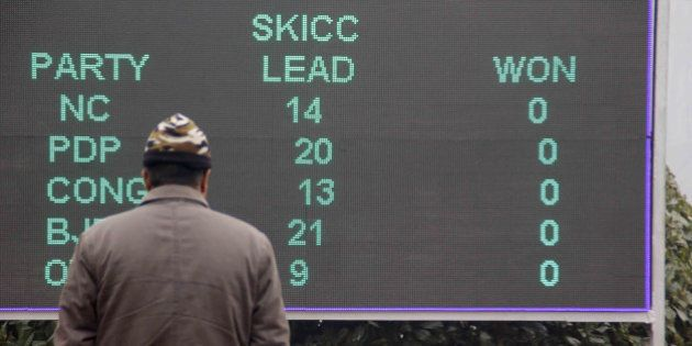 SRINAGAR, INDIA - DECEMBER 23: A man looks at a result board in Sher-e-Kashmir international convention...