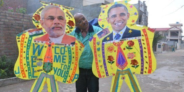 AMRITSAR, INDIA - JANUARY 21: An Indian kitemaker poses with kites adorned with images of US President...