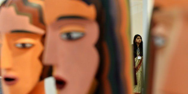 In this photograph taken on January 29, 2015 an Indian woman looks on during the India Art Fair in New...