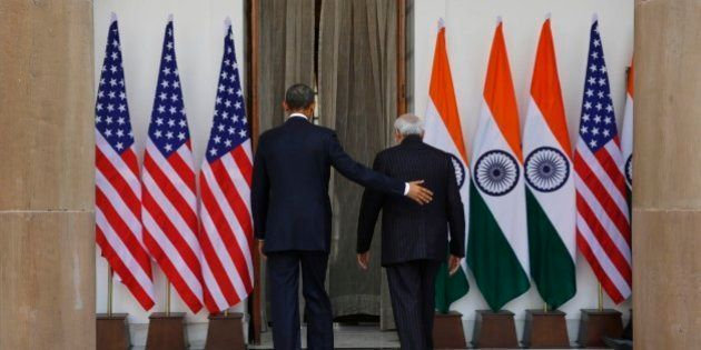 U.S. President Barack Obama, left and Indian Prime Minister Narendra Modi walk into the Hyderabad House,...