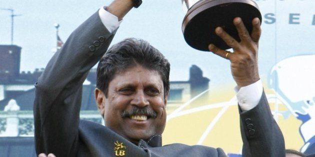 Kapil Dev, captain of the 1983 World Cup winning Indian cricket team holds up the actual cup won in 1983...