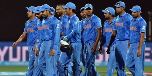 India's team celebrate their victory over Pakistan in the Pool B 2015 Cricket World Cup match between...