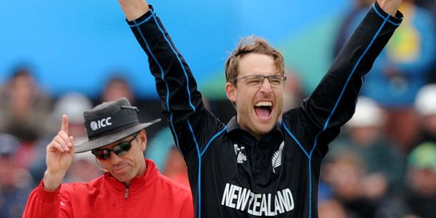 New Zealand's Daniel Vettori, right, celebrates the wicket, confirmed by umpire Nigel Long, left, of...