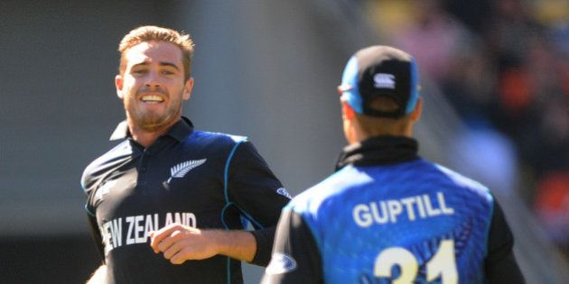 New Zealand's Tim Southee left, celebrates with teammate Martin Guptill after dismissing England's...