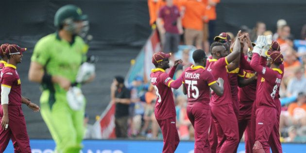 West Indies player's celebrate after dismissing Pakistan's captain Misbah Ul Haq, left, during their...