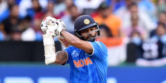 India's Shikhar Dhawan hits the ball to the boundary during their Cricket World Cup pool B match South...