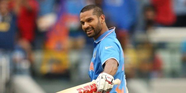 India's Shikhar Dhawan celebrates his hundred during their Cricket World Cup pool B match against South...