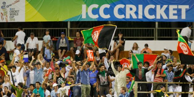 Cricket fans from Afghanistan wave their national flag and cheer for their team during the Cricket World...