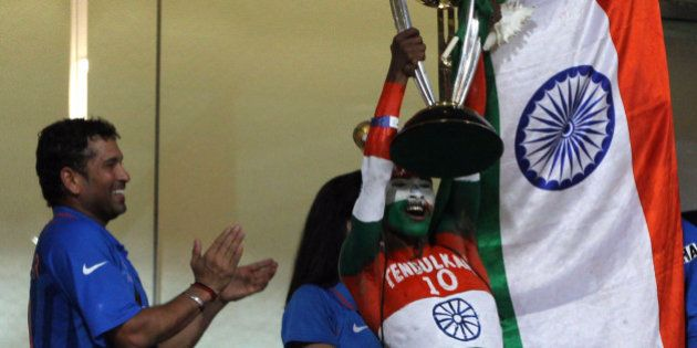 MUMBAI, INDIA - APRIL 2: Indian cricket fan Sudhir Kumar Gautam lifts the 2011 ICC World Cup trophy as...