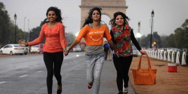 NEW DELHI, INDIA - MARCH 7: Girls enjoying rain weather on the eve of International Women's Day at Rajpath...