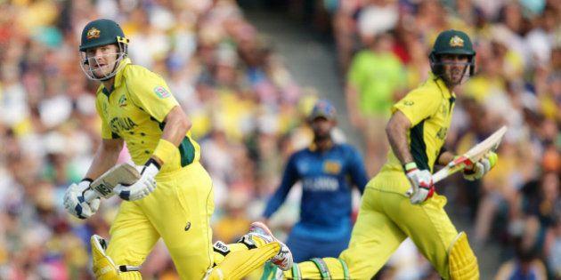 Australian batsmen Shane Watson, left and Glenn Maxwell run while batting against Sri Lanka during their...