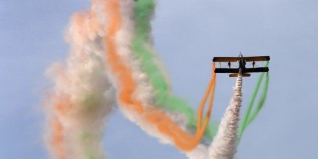 Catwalk or Skycats of the Scandinavian Aerobatic Team leave a trail of Indian tri-colour smoke as they...