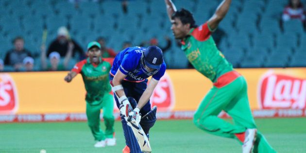 England's James Anderson is bowled by Bangladesh's Rubel Hossain, right, during their Cricket World...