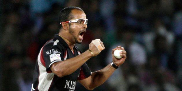Somerset bowler Murali Kartik celebrates the wicket of Kolkata Knight Riders player Manvinder Bisla by...