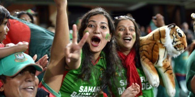 Bangladeshi fans celebrate their team's victory in the 2015 Cricket World Cup Pool A match between Bangladesh...