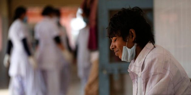 In this Monday, Feb. 3, 2014 photo, a tuberculosis patient Manjeet Mishra, 18, sits outside a ward at...