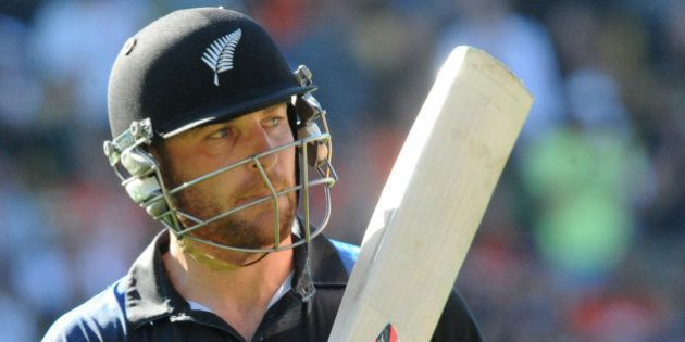 New Zealand batsman Brendon McCullum waves his bat as he leaves the field after he was dismissed for...