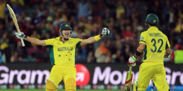 Australia's Shane Watson, left, celebrates with teammate Glenn Maxwell after they defeated Pakistan by...