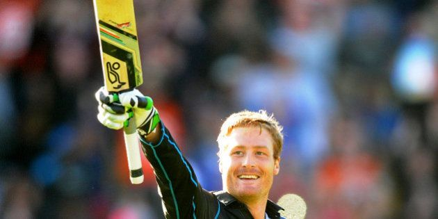 New Zealand's Martin Guptill celebrates after scoring a double century while batting against the West...
