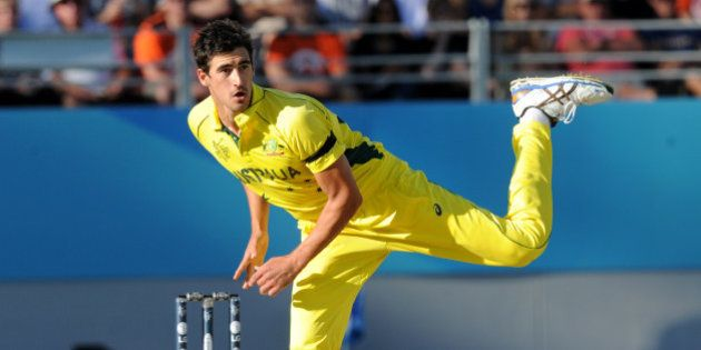 Australian bowler Mitchell Starc watches his delivery during their Cricket World Cup match against New...