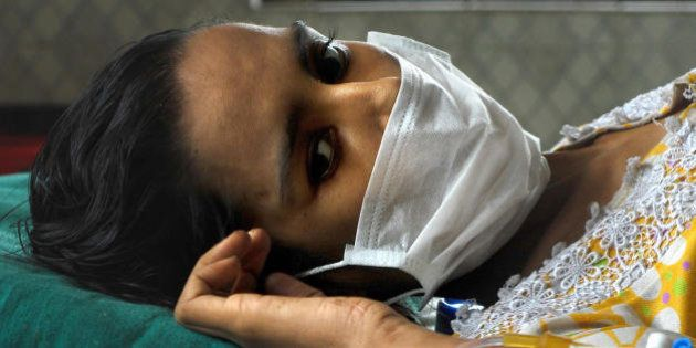 Indian Tuberculosis (TB) patient Sushma Bhat (30), lies on a bed in the TB Civil Hospital in Ahmedabad...
