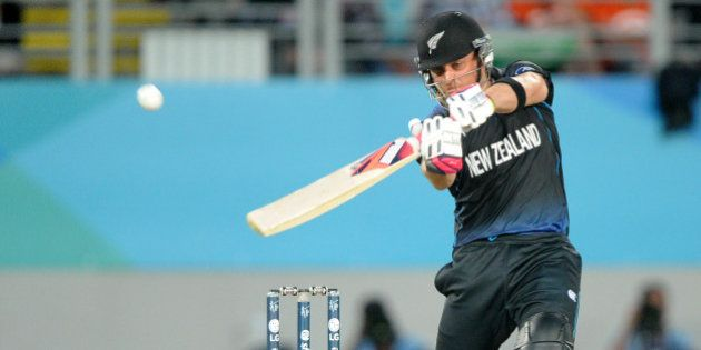 New Zealand's Brendon McCullum hits the ball for six runs while batting against South Africa during...