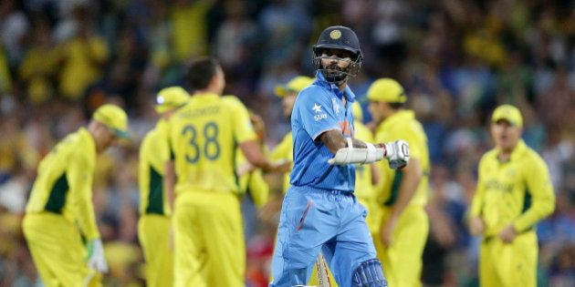 India's Shikhar Dhawan walks from the field after he was dismissed for 45 runs while batting against...
