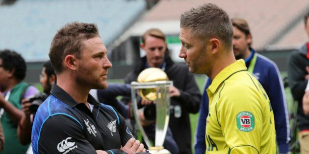 Australia's captain Michael Clarke right, and New Zealand's captain Brendon McCullum chat during a...