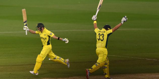 Australia's Shane Watson, right, and Steve Smith raise their bats and take the final run for their seven...
