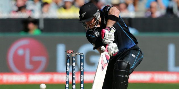 New Zealand captain Brendon McCullum is bowled for no score by Australia's Mitchell Starc during the...
