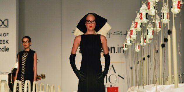 A model showcases creations by Indian designer Rajesh Pratap Singh during Amazon India Fashion Week Autumn-Winter...