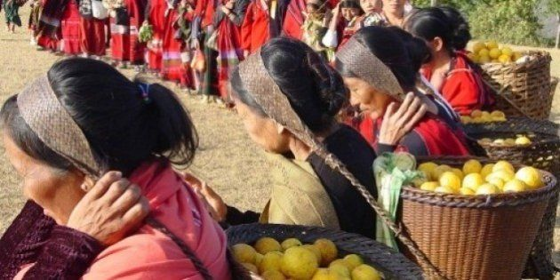 Tangkhul women carrying headload of freshly plucked lemons on theirs way for exhibition during the Lemon...