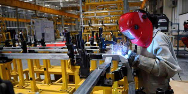 An Indian woman employee of Scania works at the company's new manufacturing facility in Narasapura, some...