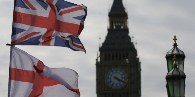 The Union, top, and England flags fly over a souvenir shop on Westminster Bridge in London, Thursday,...