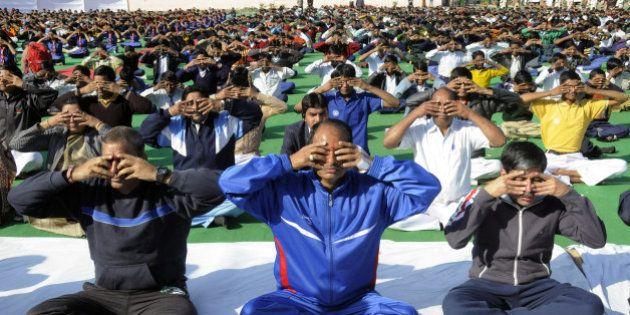 India's Madhya Pradesh state Chief Minister Shivraj Singh Chouhan (C) joins schoolchildren in a mass...