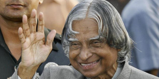 New Delhi, INDIA: India's outgoing President A P J Abdul Kalam waves while meeting guests during a reception...