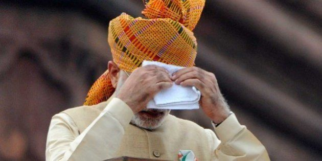 NEW DELHI, INDIA - AUGUST 15: Prime Minister Narendra Modi wipes his face as he addresses the nation...