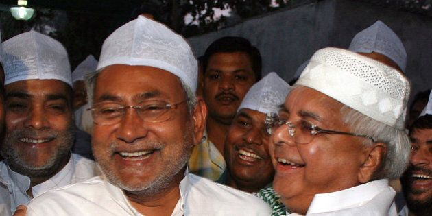 Indian Railway Minister Laloo Prasad Yadav, right, hugs Chief Minister of Bihar state Nitish Kumar during...