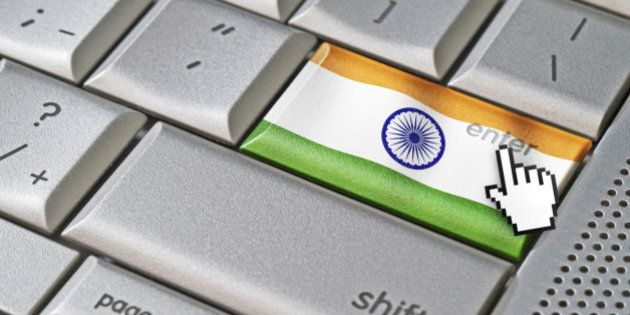 Business concept mouse cursor pressing India enter key on metallic