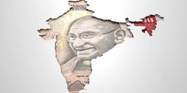 The shape of the country of India in the colours of its national rupee currency recessed into an isolated...