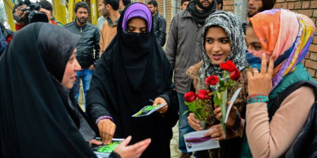 SRINAGAR, KASHMIR- NOVEMBER 12: A group of Muslim girls present red roses to the Muslim girls for wearing...