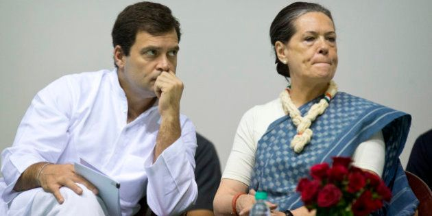 Congress party President Sonia Gandhi, right, and her son and Vice President Rahul Gandhi listen to a...