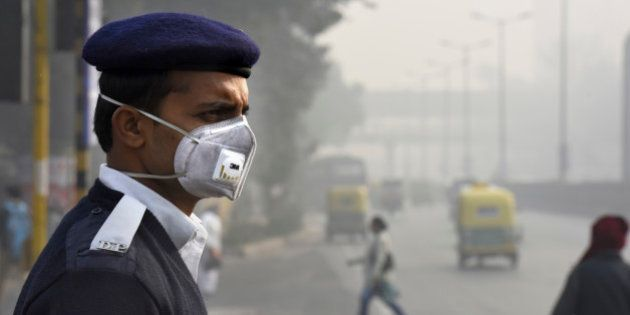 NEW DELHI, INDIA - JANUARY 4: People and traffic police wearing a mask during the implementation of odd-even...