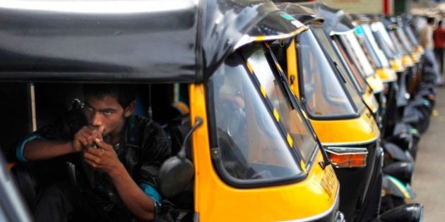 A man sits inside a motorized three wheeler called auto rickshaw, during a strike in Mumbai, India, Monday,...