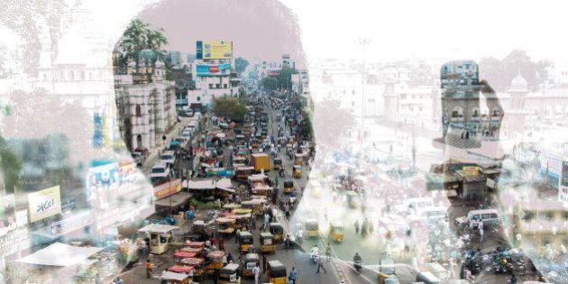 double exposure of a man taking a photo with a smart phone in India and