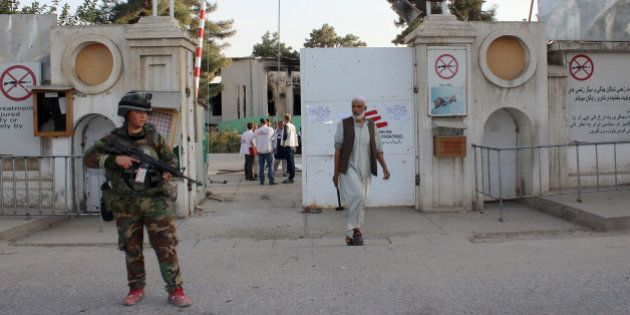 An Afghan National Army soldier stands guard at the gate of a Doctors without Borders hospital after...